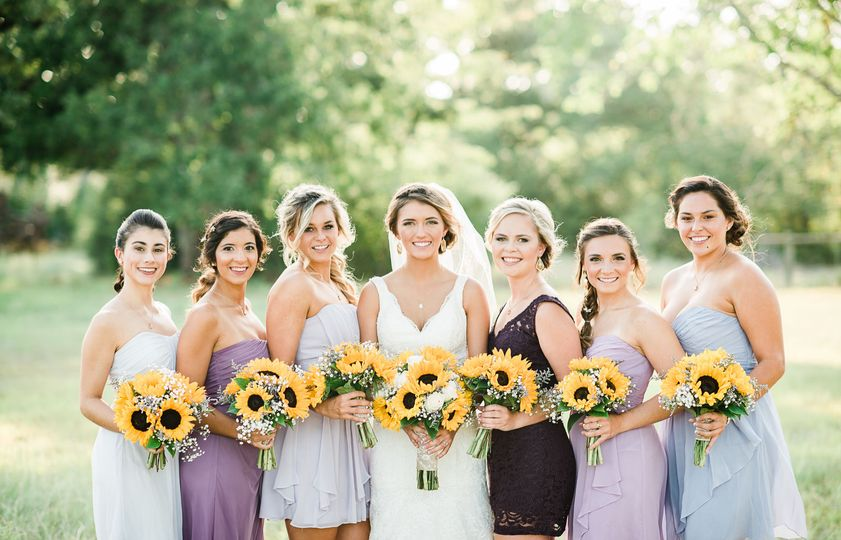 Bridal party and their sunflower bouquets