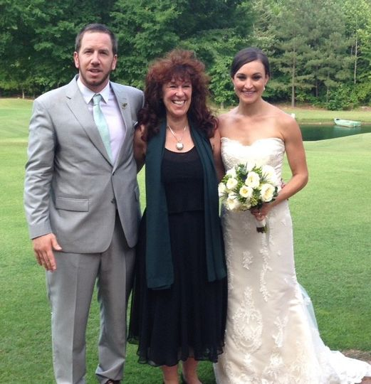 The groom, officiant and the bride