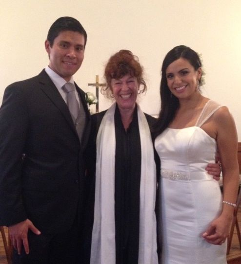 The newlyweds with the officiant