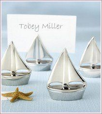 At weddingbellebridal.com you will find fabulous place card holders that serve as guest favors too!