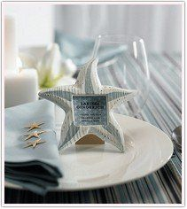 A perfect beach themed place card holder, so unique! Guests can take these home and add a special...