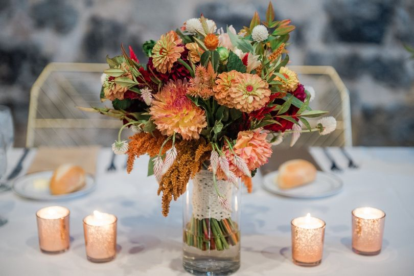 Warm-toned bouquet and candles