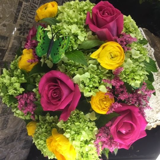 Green hydrangeas and pink and yellow roses