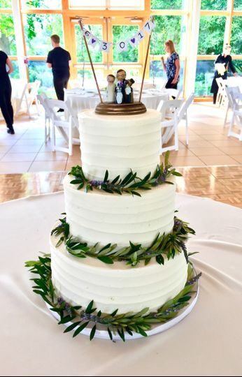 Three tier wedding cake with grass