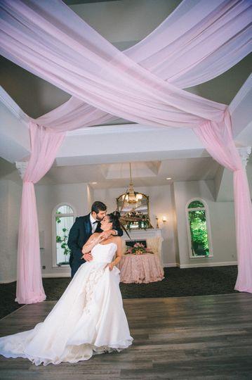 Newlyweds in ballroom