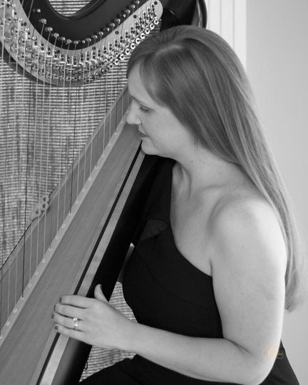 Emily playing her harp