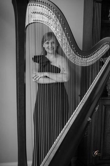 Emily behind her harp