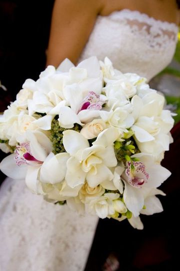 Bride's bouquet of gardenias, orchids, freesia, and roses. Photo: Tana Photography