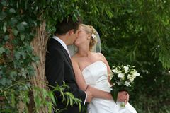 Lisa and Luke share a kiss after the ceremony
