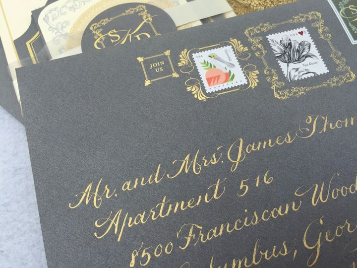 Gold lettering to match the gold foil decoration on the envelopes.