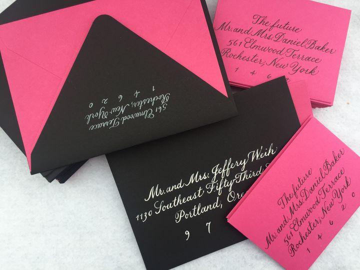 Striking white lettering on black envelopes.