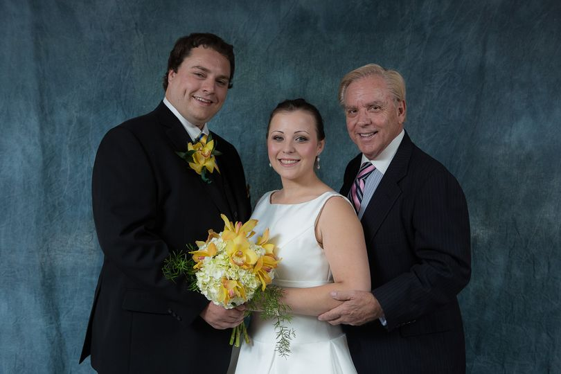 The couple with the officiant, Mr, Jeffrey