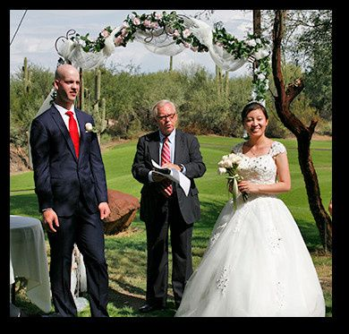 The couple with the officiant, Mr, jerffrey