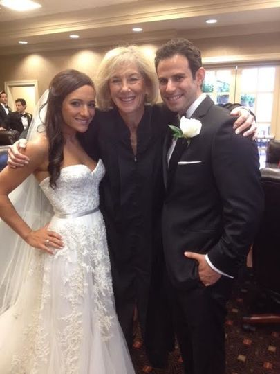 Officiant with the newlyweds