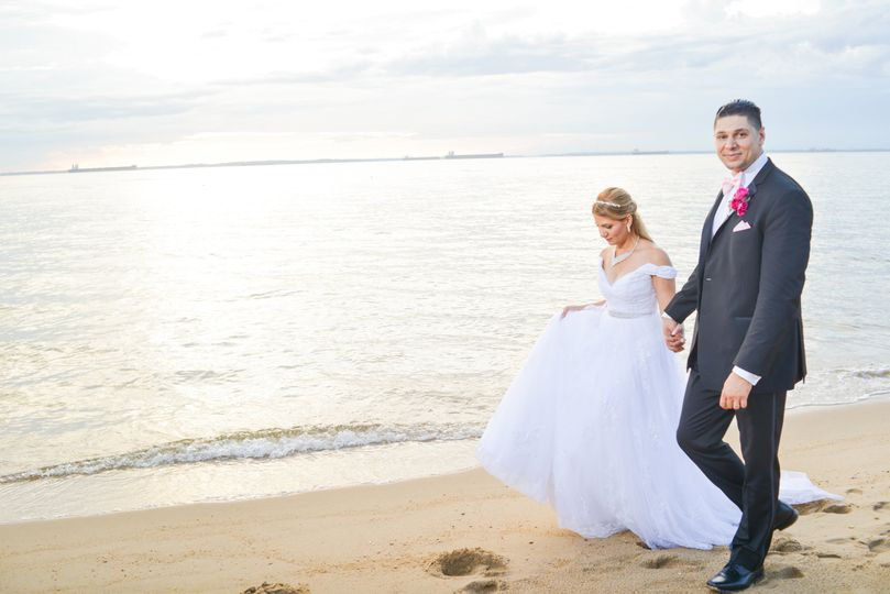 A seaside stroll as newlyweds