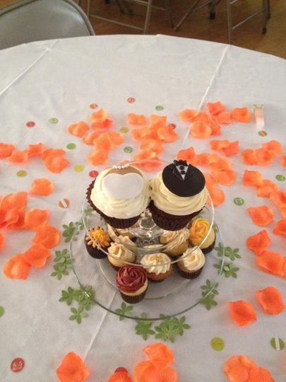 Custom centerpieces with bride and groom cupcakes
