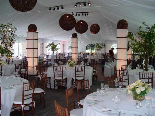 An elegant tent wedding with light columns and decor by Eggsotic Events