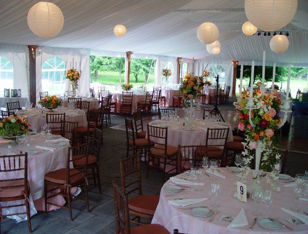 Another gorgeous tent wedding with lanterns, wood columns, and candelabra floral arrangements