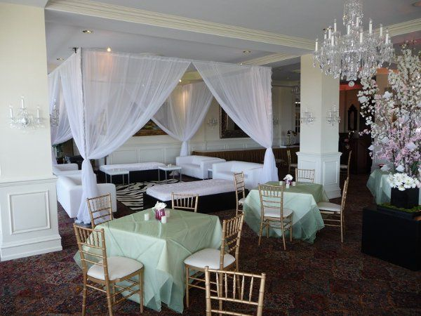 A draped lounge, seating and cherry blossom arrangements at Trump National Golf Club in Bedminster,...
