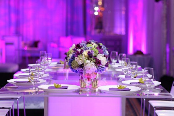 Purple floral tablescape on our glowing high-top dinner table