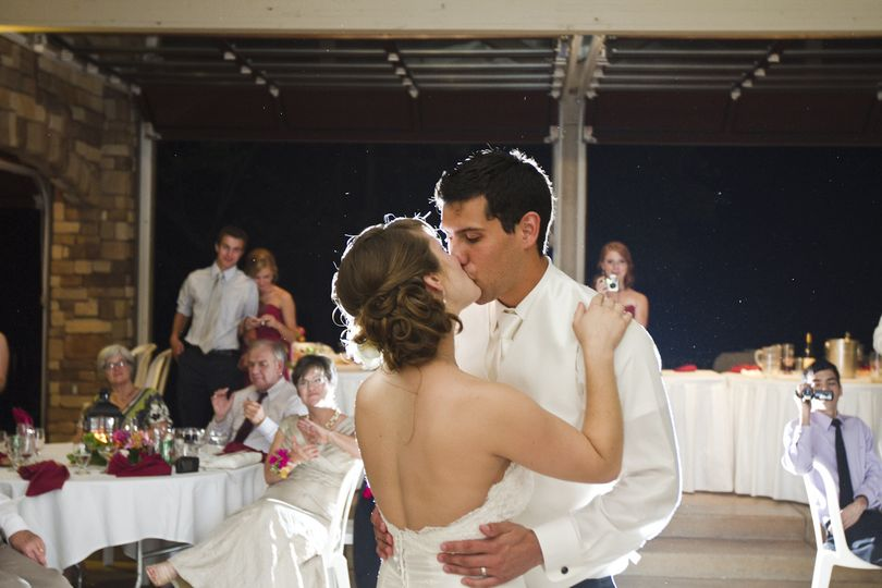 """Becca and Robby during their first dance to """"Marry You"""" -- a custom song written for them by Jessica..."""