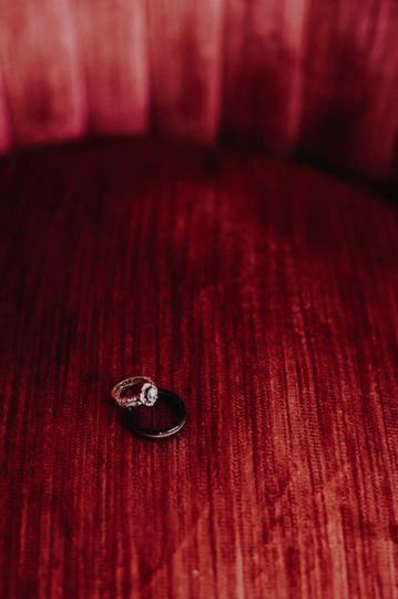Wedding rings on red cushion
