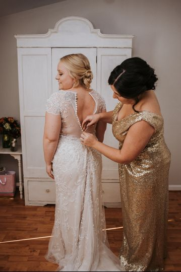 Buttoning up wedding dress