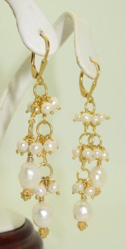 The lovely earrings are designed with small freshwater pearls cascading like a waterfall. The...