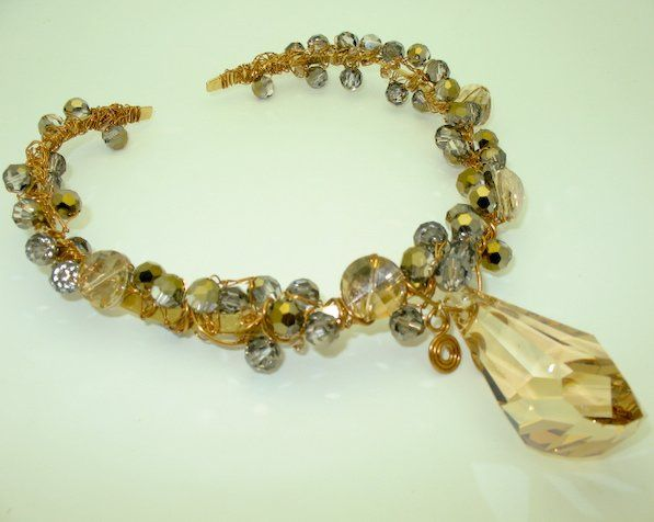 This necklace is uniquely designed with a combination of faceted swarovski golden shadow and...