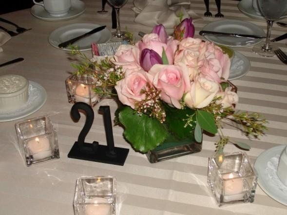 "Square 4"" vase, $3.00 Square votive holders, $1.00 (includes tealight)"
