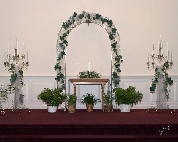 Silver spiral arch, $30.00 9 light silver candelabra, $18.00