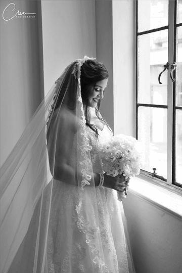 A beautiful bride last minute before she says I do .