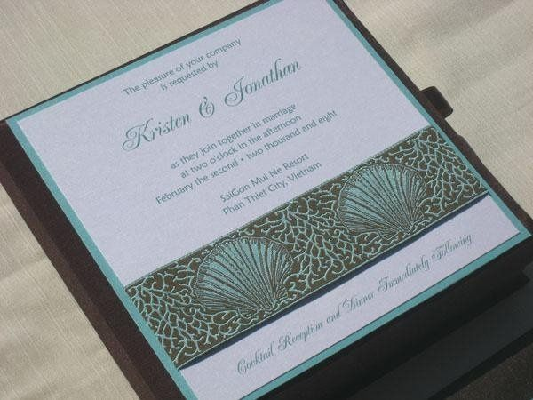 Fashioned of vanilla shimmer paper on a soft aqua backing, set off in rich cocoa script, and...