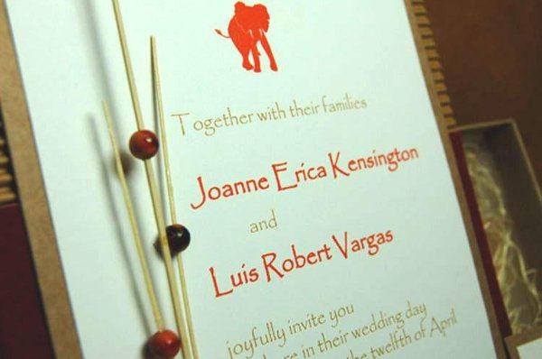 Whimsical, elegant and organic, this original couture invitation was designed with a one-of-a-kind...