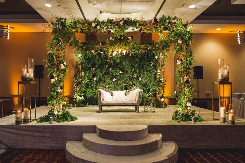 Stage draped in greenery