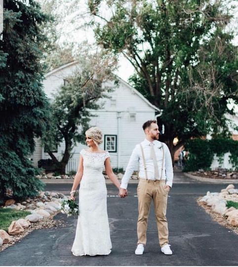 Holding hands on a driveway