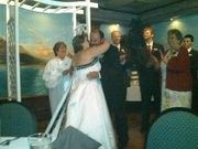 Peggy and Peter seal their vows at Papagallo's restaurant in Keene, NH.