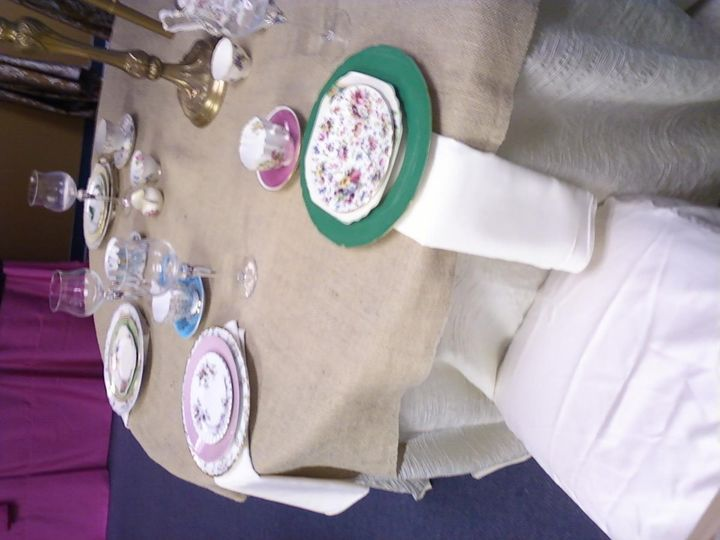 Display at LinenHero Atlanta of Vintage Mismatched Fine China on Soft Burlap Linen