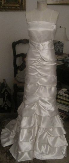 This custom made gown is made with 100 percent ivory silk satin, strapless, and has a silver...