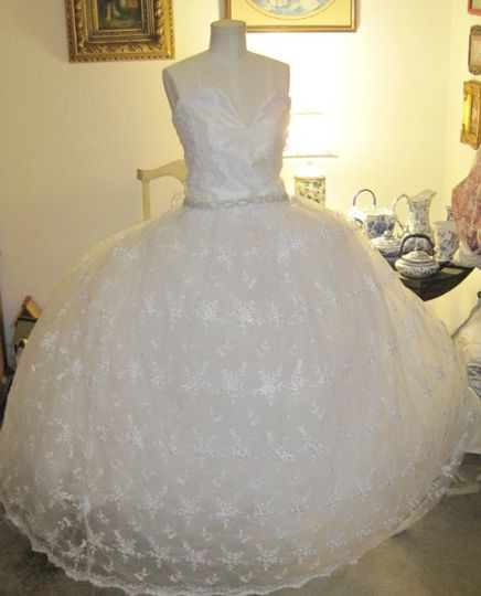 This ball gown is fit for a princess, made of 100 percent silk lace, with a large tulle under skirt....