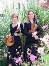 Susan Salmon plays mandolin, guitar, and violin.