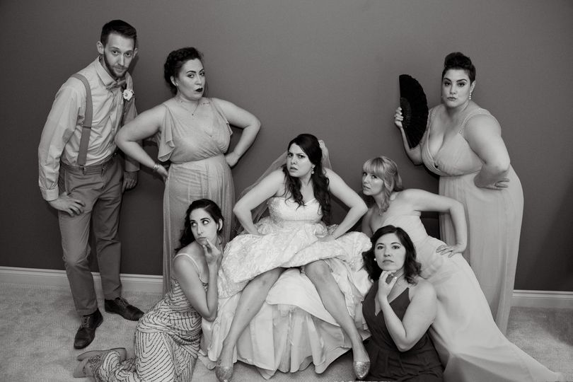 A bridal party hams it up before their lakeside wedding in White Lake, Michigan.