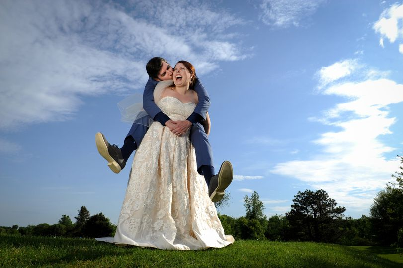 A fun and silly New York couple reverse rolls by having the groom climb on the bride's back at White...