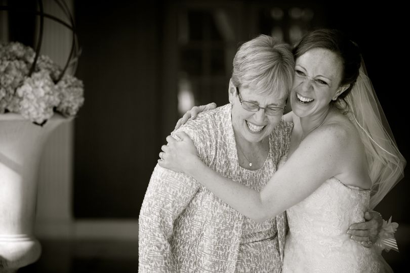A bride hugs her grandmother who was also the officiant at her wedding in Dearborn, Michigan.