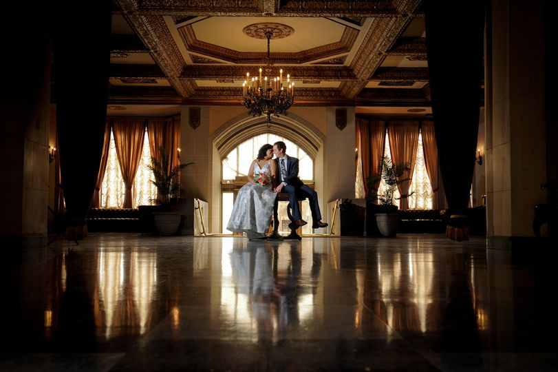 A couple relaxes during their wedding at Detroit, Michigan's Masonic Temple.