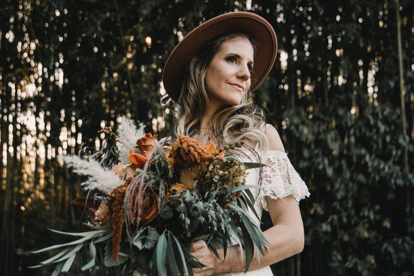 Bride in hat with bouquet