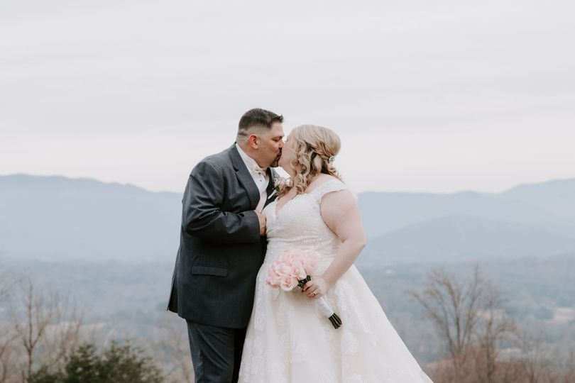 Couple kissing on a mountain top