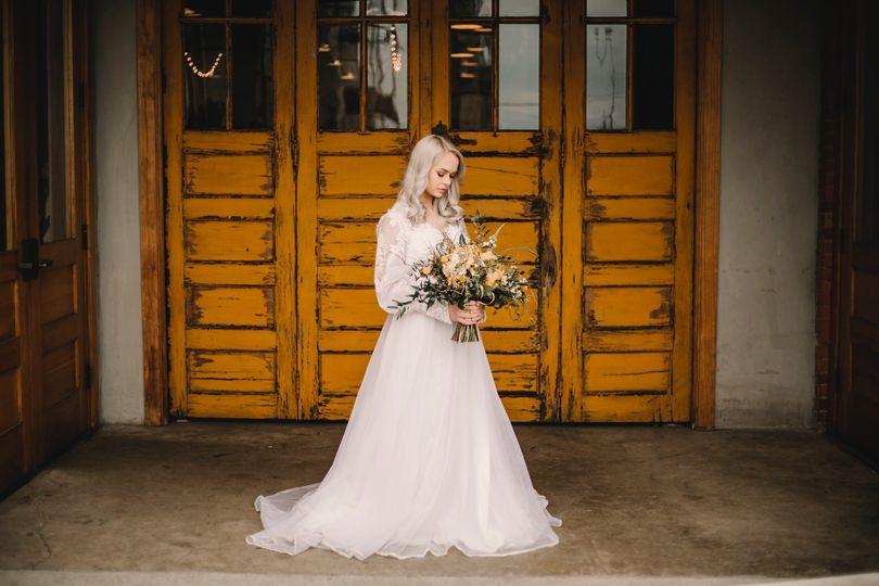 Bride in front of yellow door