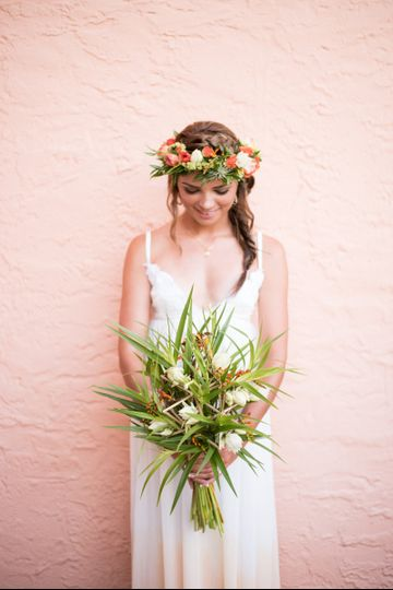 Lovely bride with bouquet and flower crown