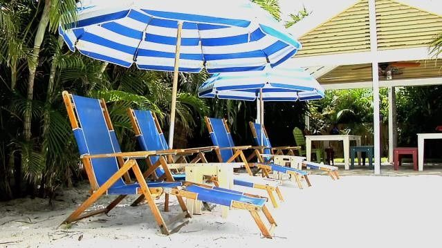 Lounge chair and umbrella at the sand area